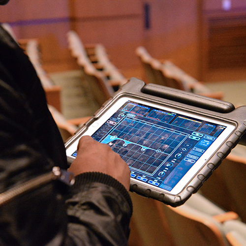 Theatre Tech student using tablet